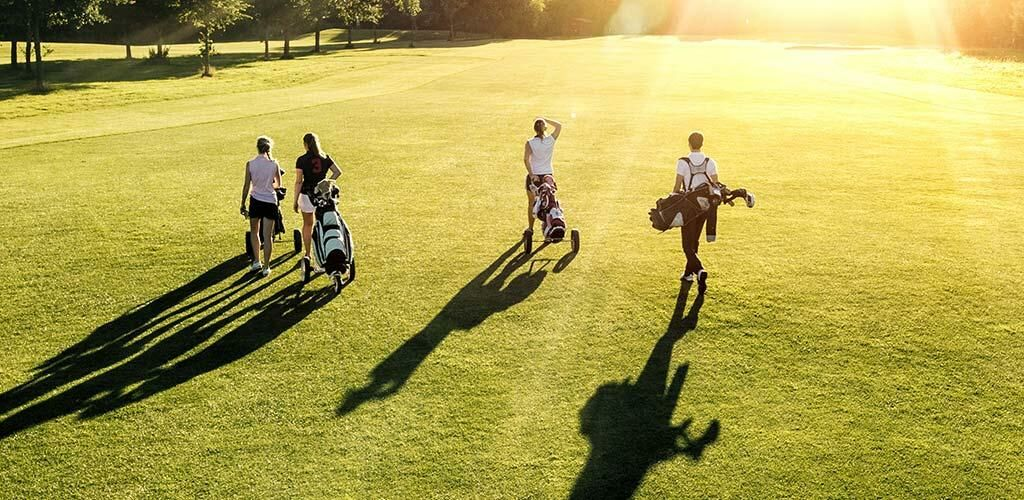 A group of four people golfing