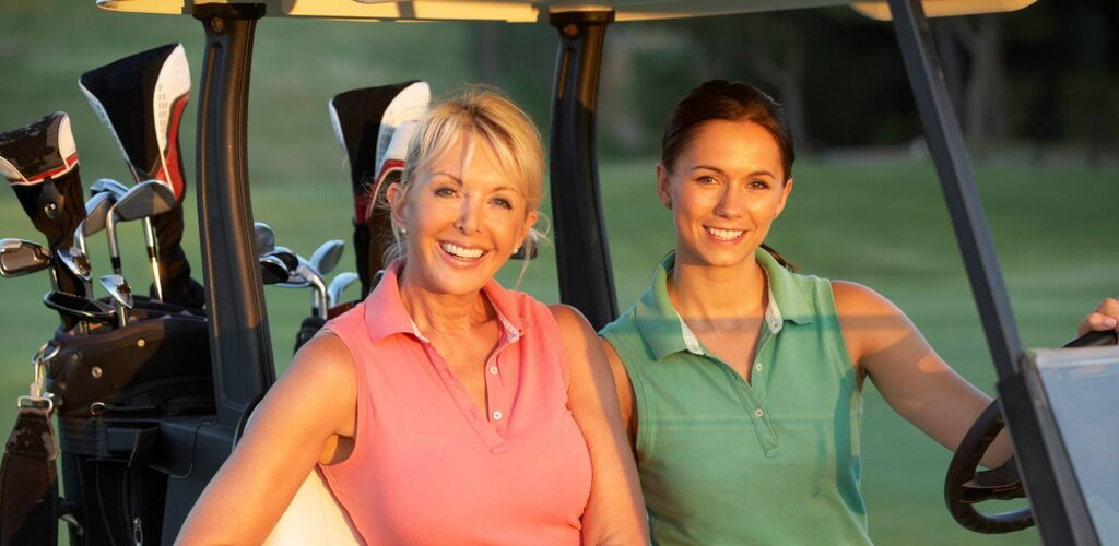 Two Ladies Golfing